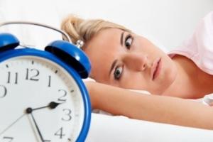 11275893 - clock with sleep at night. woman can not sleep.